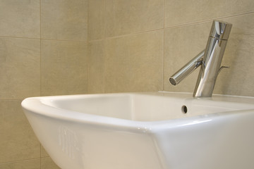 Closeup of contemporary hand-basin and tap