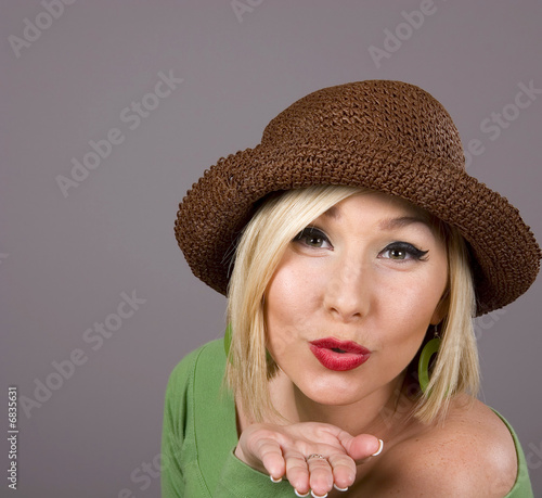 Blonde Brown Hat Blowing Kiss