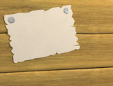 3d sheet of a paper, attached by buttons to board poster