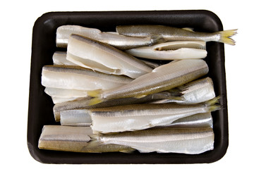 Isolated Headless Smelt Fish in a black container