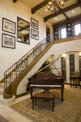 Luxury home grand piano and stairs.