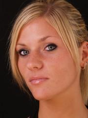 Young blond woman closeup portrait serious