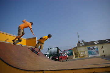 2 skaters on a mini ramp