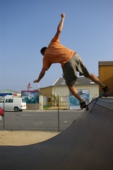 skater performing on a mini ramp
