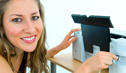 smiling office girl inserting a cable