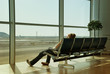Leinwanddruck Bild - Lonely girl waiting in airport