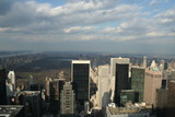sole e nuvole sul panorama di New York poster