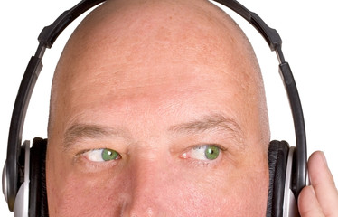 Male listening to music on headpohones