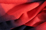 Scarf from  wool  red black color, laying soft folds poster