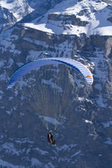Close-up of a hovering paraglider.