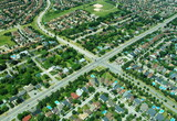 Aerial view of intersection in residential area poster