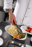 Chef preparing pasta poster