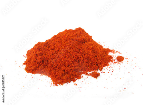 Paprika hot peppers grinded isolated on white background
