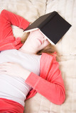 Young woman has fallen asleep reading the book poster