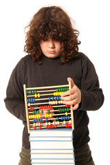 boy with abacus calculator with colored beads and books