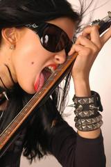 Woman licking guitar