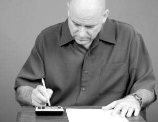 Man Working on Bills