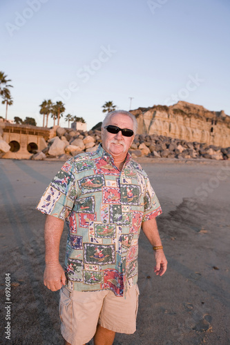 Senior Man enjoying the Beach at Sunset