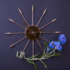 Metallic watch with bluebottle