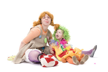 Big and little clown are making silly face