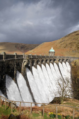 Water overflowing a dam, Craig Goch reservoir, Elan Vally Wales.