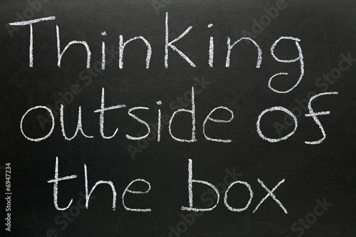 Thinking outside of the box written on a blackboard.