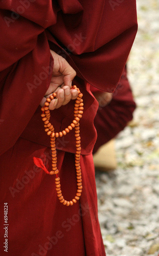 Monk's hand with bead