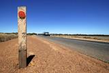 Road through the desert in Australia poster