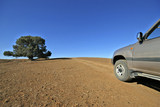 With 4WD at dirt road in Flinders range in Australia poster