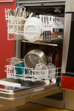 open dishwasher with clean dishes poster