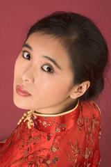 Chinese girl in red cheongsam