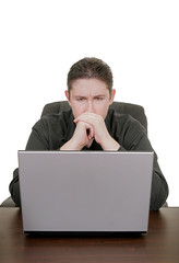 man concentrating on laptop