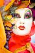 Orange and red costume in Venice