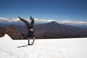 Handstand on snow at Mt Ruapehu, New Zealand.