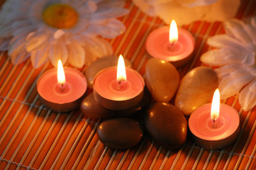 Aromatic candles and  pebbles for spa session
