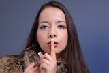 attractive woman gestures silence poster