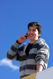 Happy  youngster speaks to the mobile telephone. poster