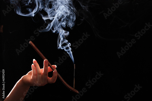 Smoking stick in the woman`s hand