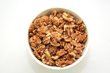 A bowl full of walnuts