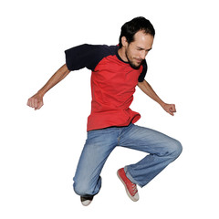Portrait of casual young man jumping - isolated on white