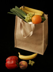 Bag of fruit and veg and scattered produce