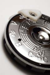 A circle pitch pipe on white background.