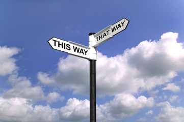 This Way That Way Which way to Turn signpost in the sky