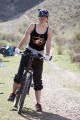 Girl in RAP bandanna by sport bicycle in spring mountain Tien Sh
