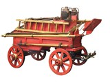 A Wooden Model of an old Horse Drawn Fire Engine. poster