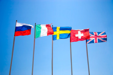 Five national flags on blue sky