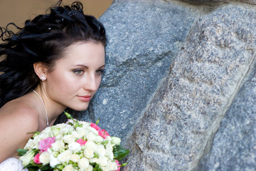 portrait with bouquet by the wall