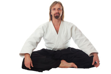 pacification teacher of aikido sit and look at camera