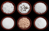 six terracotta plates with different  sea salt on black poster