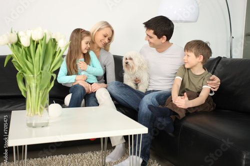 young family and a dog